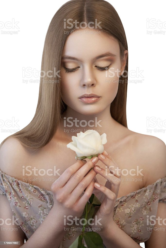 Woman with white closed eyes rose in her hands royalty-free stock photo