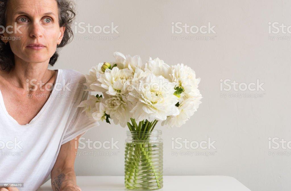 Woman with white dahlias stock photo