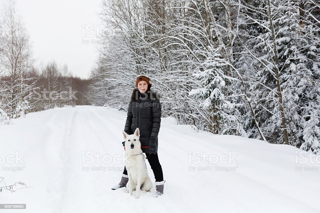 Woman with white swiss shepherd dog stock photo