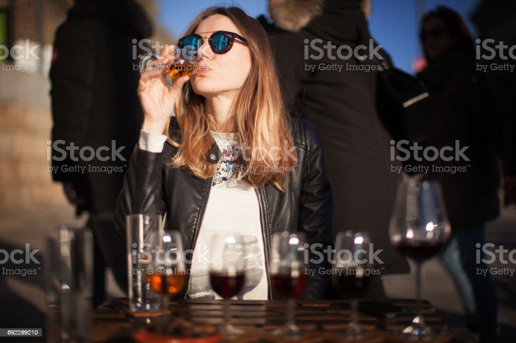 Woman with wine testing glasses stock photo