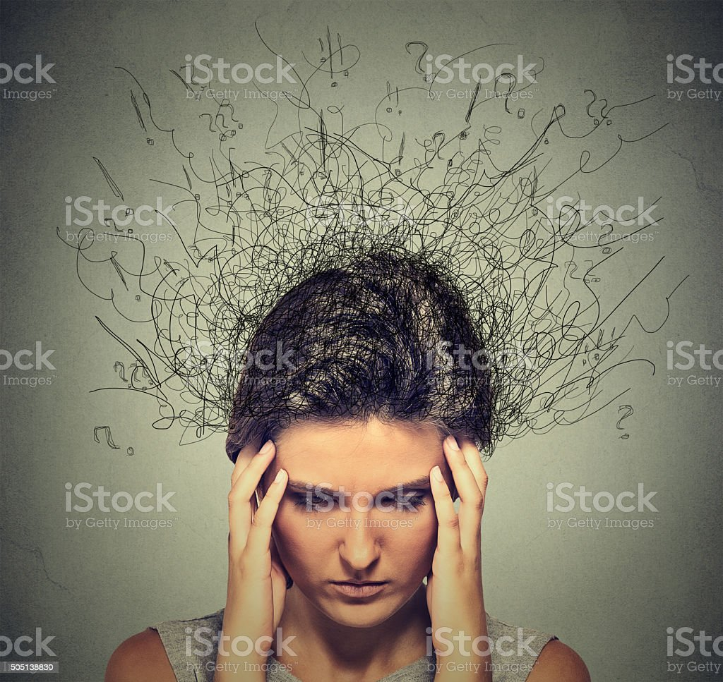 Woman with worried stressed face expression brain melting into lines stock photo