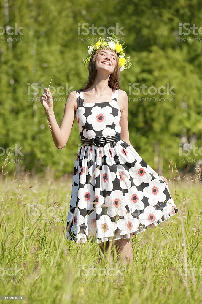 Woman with wreath on meadow royalty-free stock photo