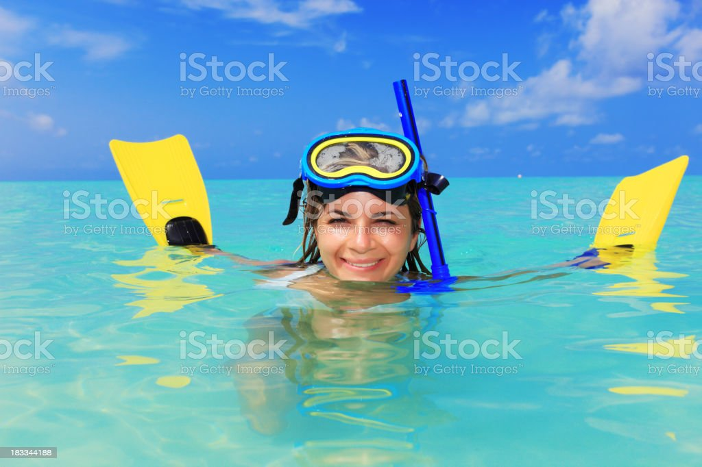 Woman with yellow flippers in blue ocean royalty-free stock photo