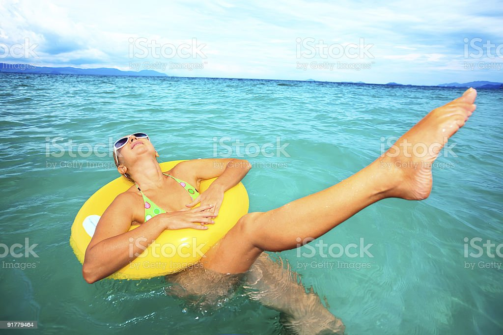 Woman with yellow tube royalty-free stock photo