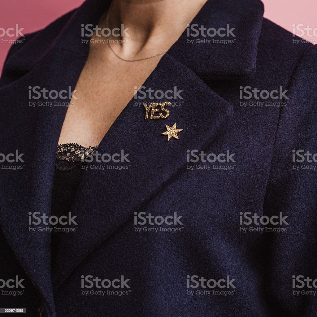 Woman with yes pin on her coat stock photo
