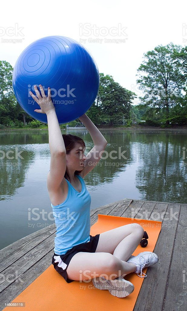 Woman with yoga ball royalty-free stock photo