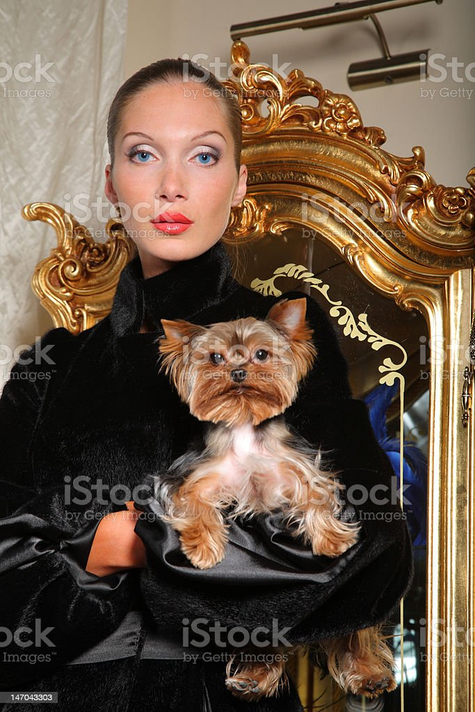 Woman with yorkshire terrier royalty-free stock photo