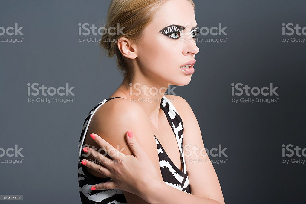 Woman with zebra stripe eye makeup stock photo