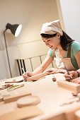 woman woodworking smile happily