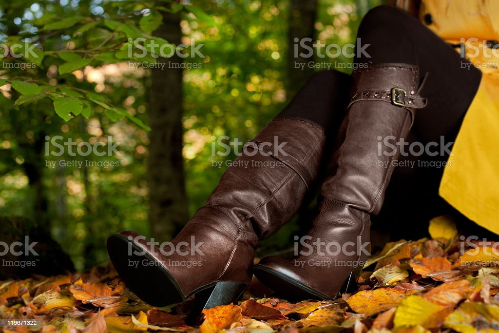 Woman wore leather boot in forest royalty-free stock photo