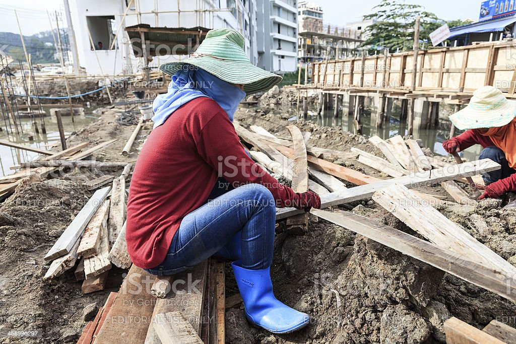 Woman work at a construction site royalty-free stock photo
