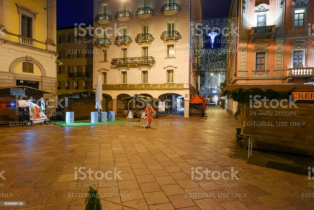 Woman worker cleaning the central square with the christmas mark stock photo
