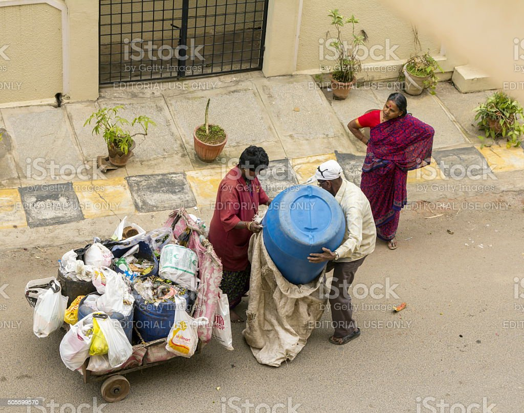 Woman worker collects garbage in Bangalore, India stock photo
