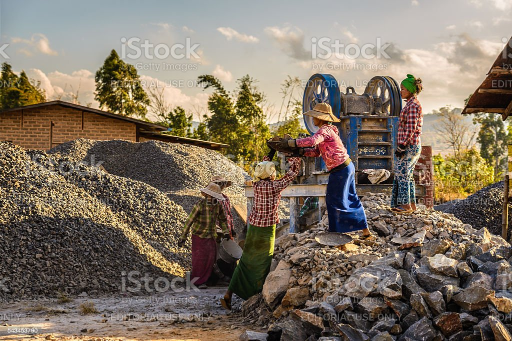 Woman workers work in a quarry stock photo