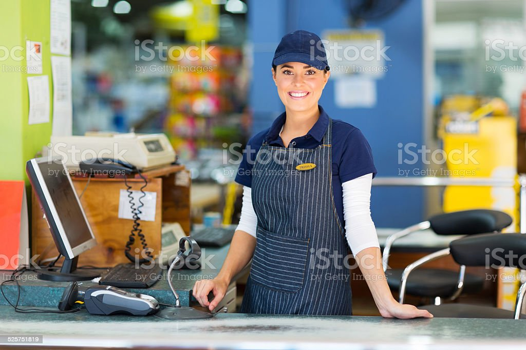 woman working as a cashier at the supermarket stock photo