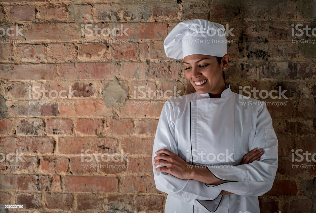 Woman working as a chef stock photo