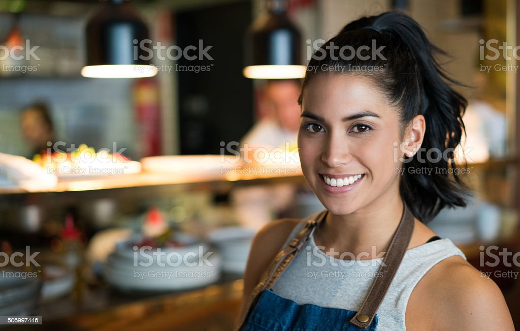 Woman working as a waitress at a coffee shop stock photo