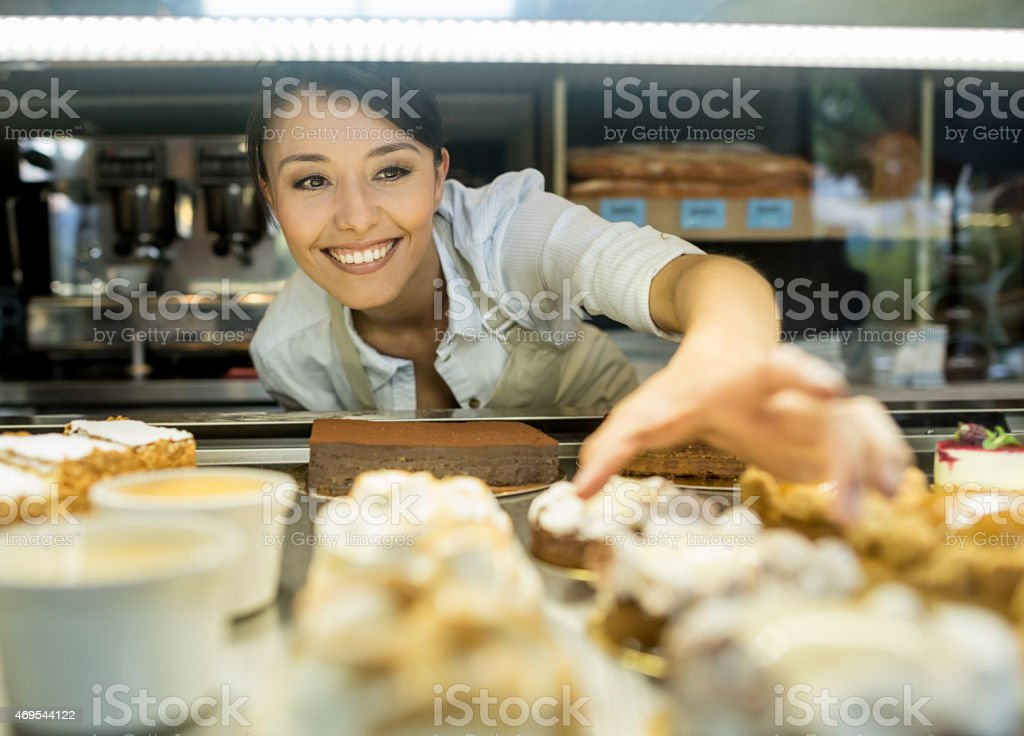 Woman working at a bakery stock photo
