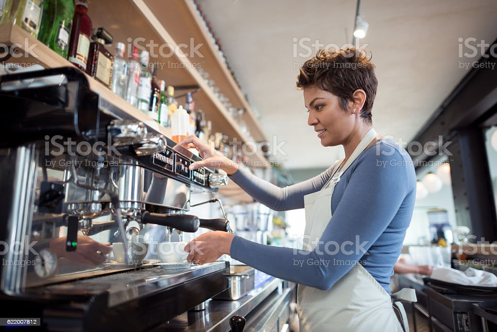 Woman working at a cafe stock photo