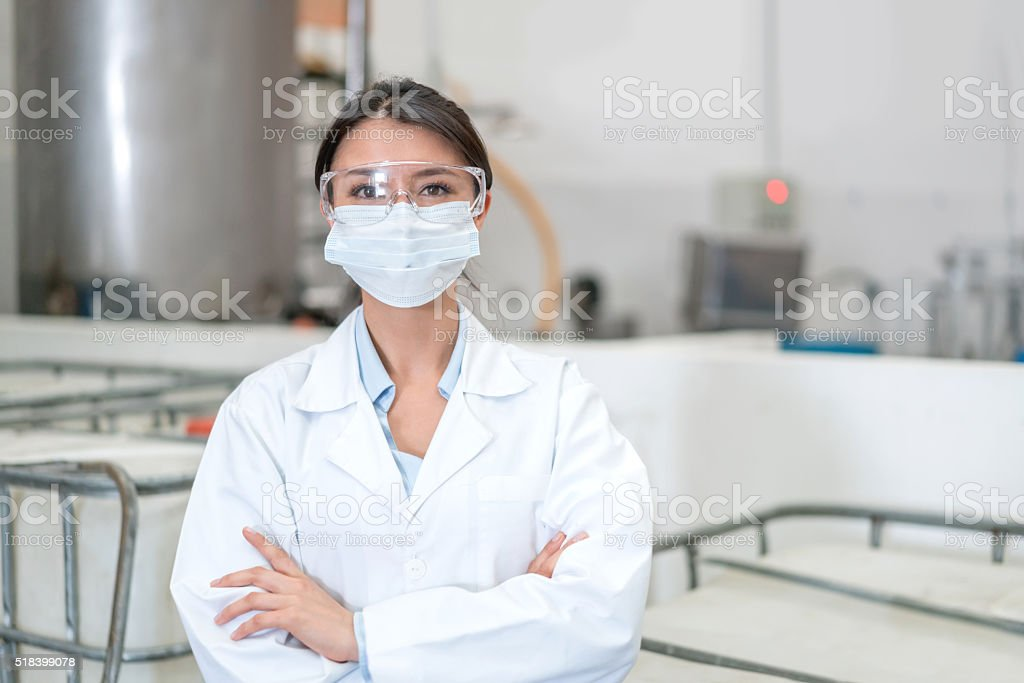 Woman working at a chemical factory stock photo