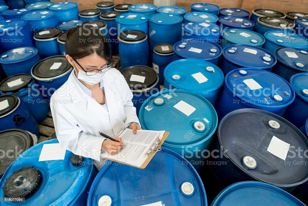 Woman working at a chemical plant stock photo