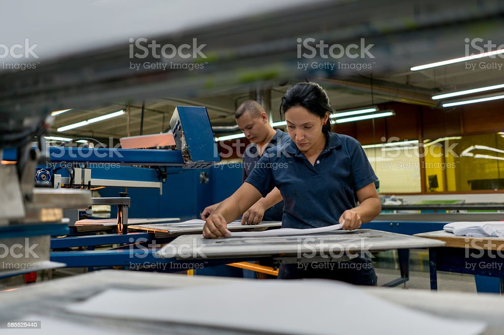 Woman working at a clothing factory stock photo