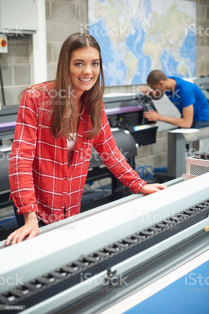 woman working at a digital printers stock photo