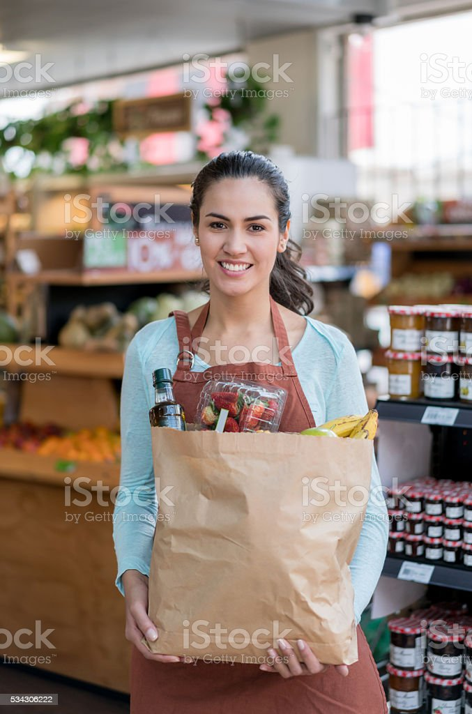 Woman working at a grocery store stock photo