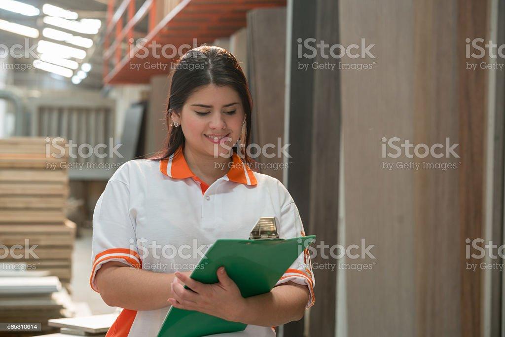 Woman working at a lumberyard stock photo