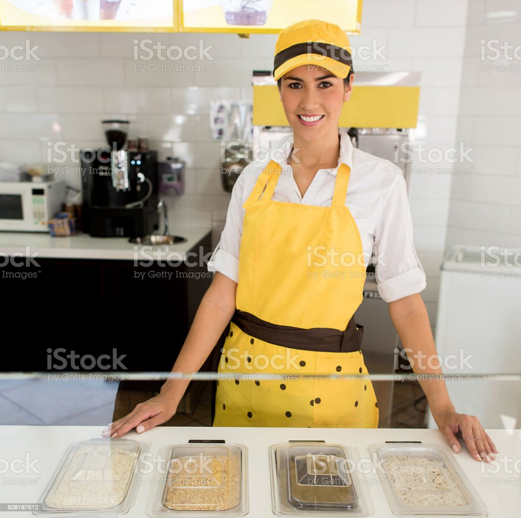 Woman working at an ice cream shop stock photo