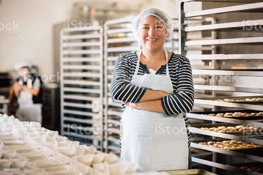 Woman working at Bakery Workshop stock photo