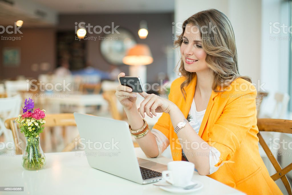 Woman working at cafe. stock photo