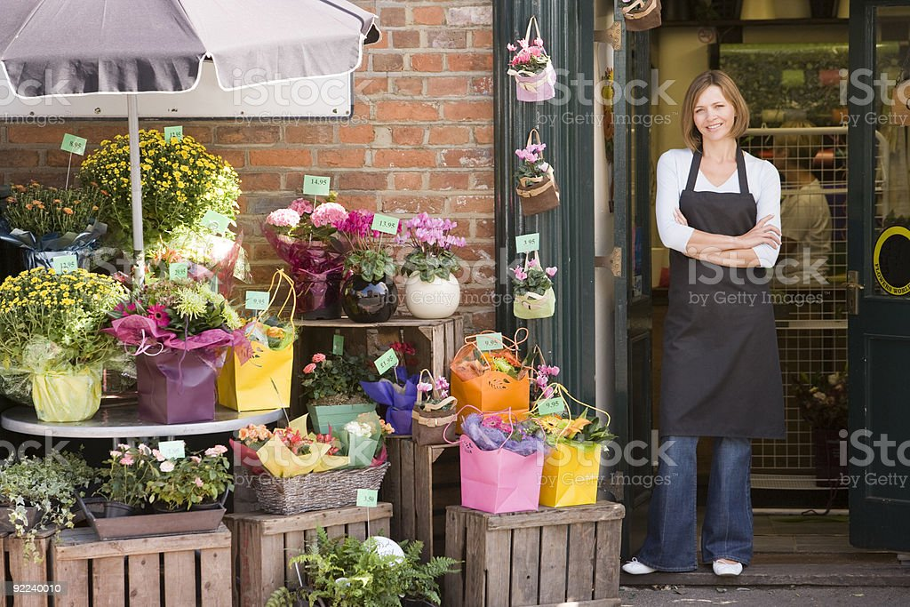 Woman working at flower shop stock photo