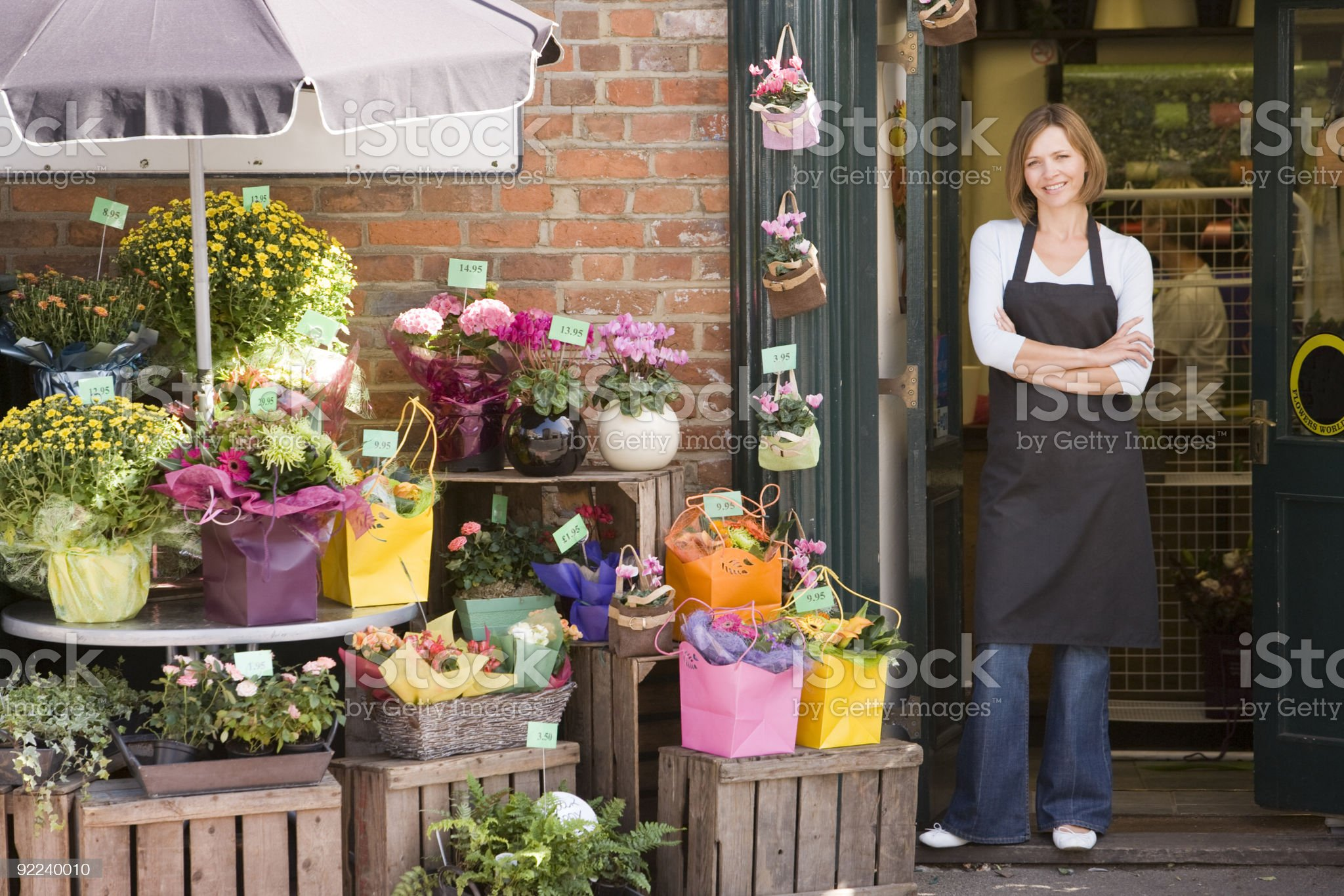 Woman working at flower shop royalty-free stock photo