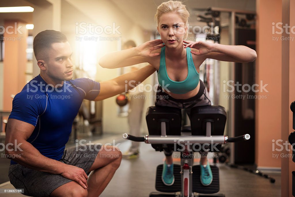 Woman working at her abdomen stock photo