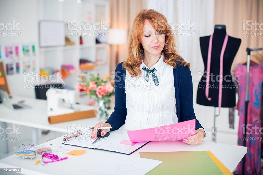 Woman working at her studio. stock photo