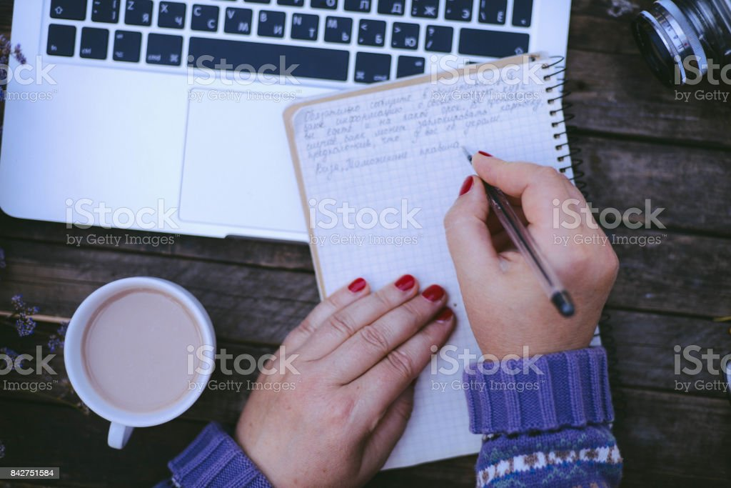 Woman working at home office hand on keyboard close up stock photo