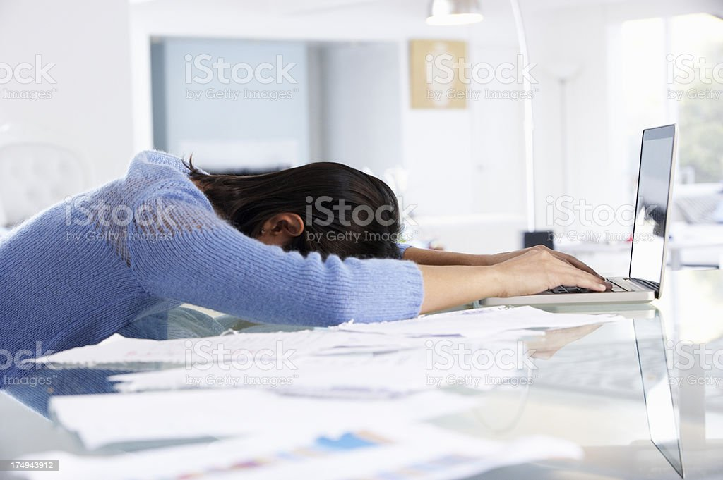 Woman Working At Laptop In Home Office royalty-free stock photo