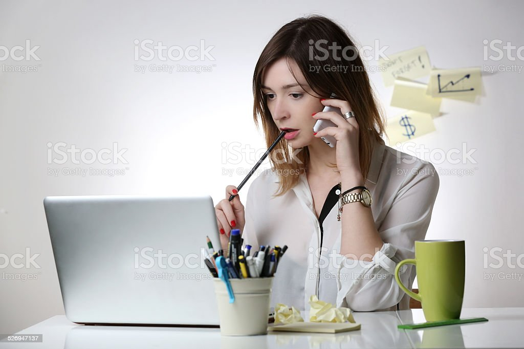 Woman working at office desk stock photo