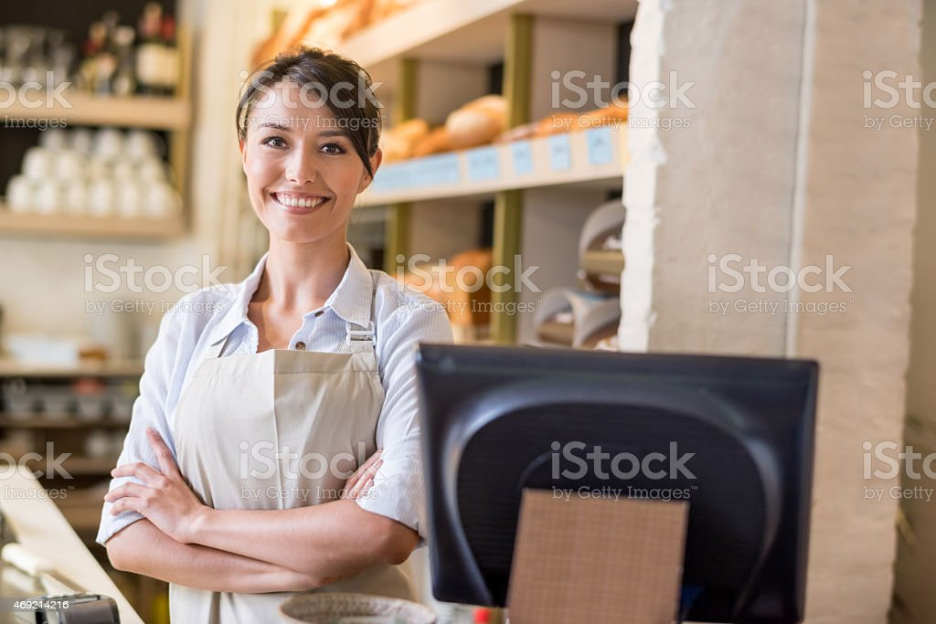 Woman working at the bakery stock photo