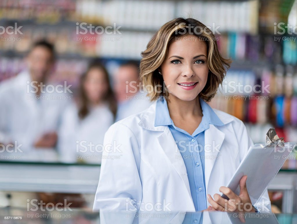 Woman working at the drugstore stock photo