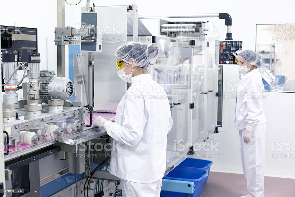 Woman working at the factory royalty-free stock photo