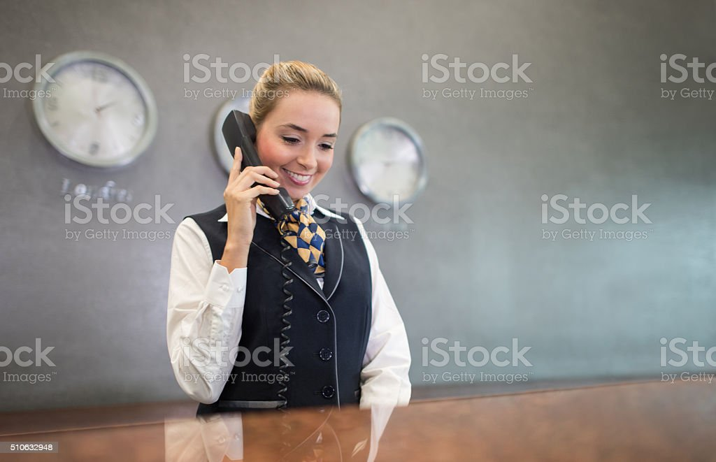 Woman working at the front desk of a hotel stock photo