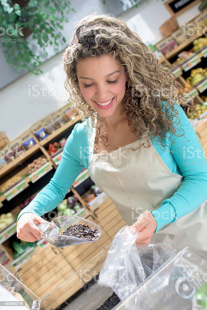 Woman working at the grocery store stock photo
