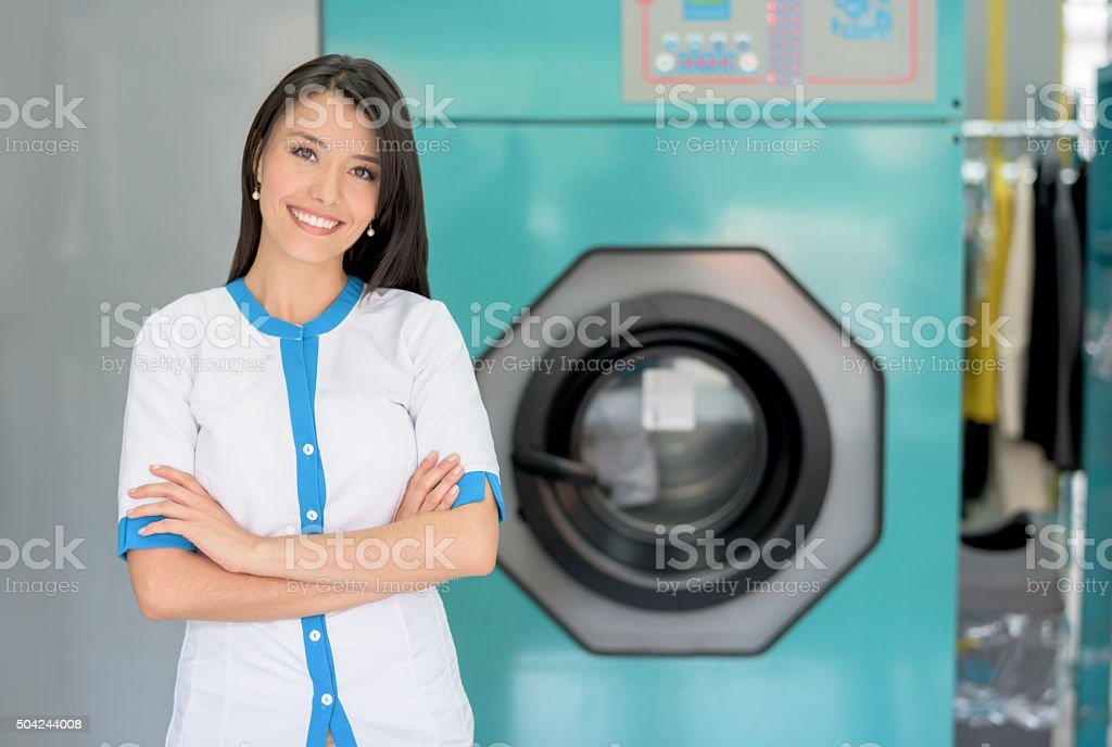 woman working at the laundry shop stock photo