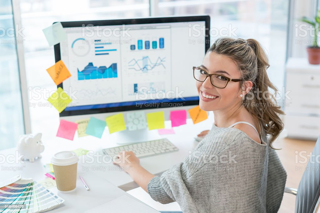 Woman working at the office stock photo