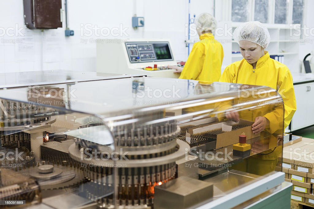 Woman working at the pharmaceutical factory royalty-free stock photo