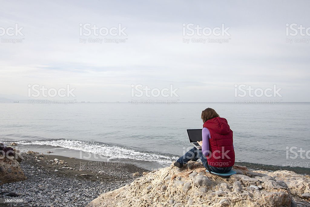 Woman working at the seaside royalty-free stock photo