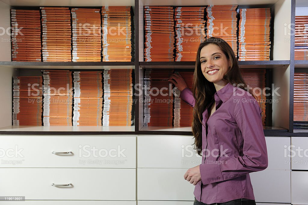 woman working at the video rental store stock photo