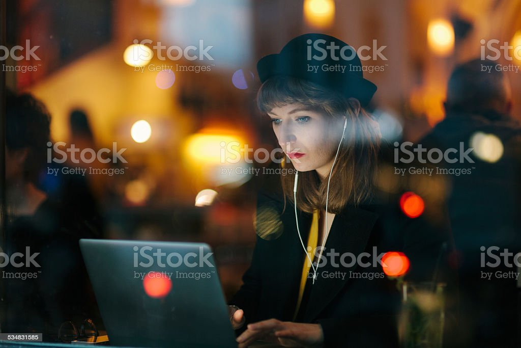 Woman Working from Cafe stock photo